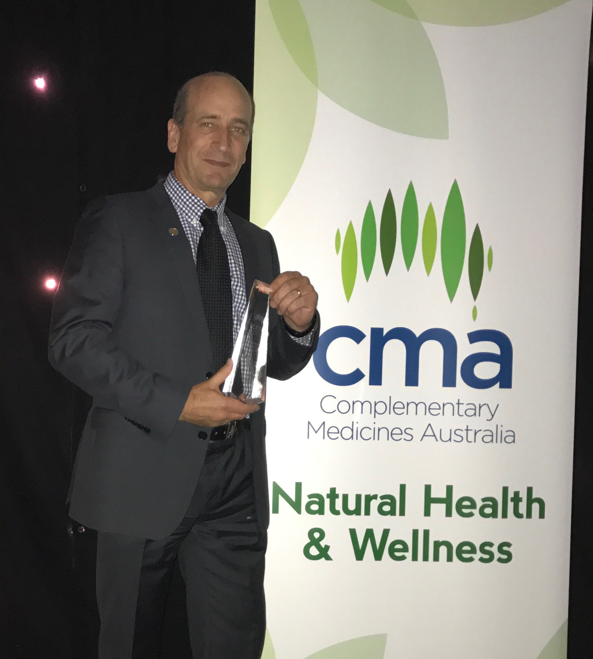 Rod Taylor, Herbalife GM accepting CMA Award1.jpg